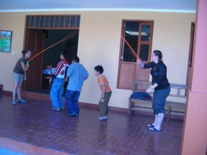 Crystal and Lisa playing jump rope with the orphans in Peru
