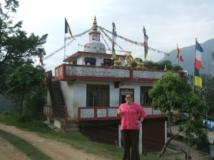 Crystal standing in front of the Buddhist Monastery in Besishar, Nepal.