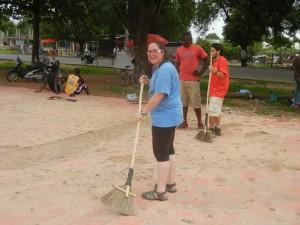 Crystal helping to demolish the old basketball court. Ghana.