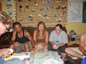 Crystal playing an epic game of Monopoly with some Peace Corps volunteers. Ghana.