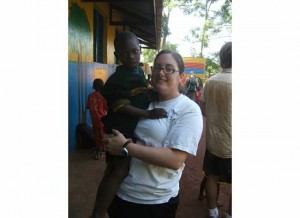 Crystal with an orphan boy in Jinja, Uganda.