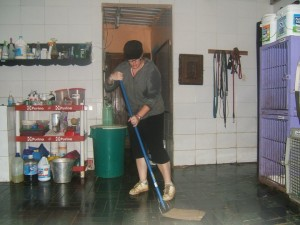 Crystal cleaning the clinic at AWARE. Guatemala.