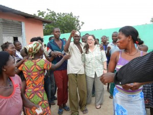 Crystal handing out condoms to villagers in Ghana.