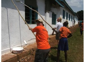 Crystal painting a school in Jinja, Uganda.