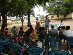 Crystal giving an HIV/AIDS presentation to villagers in Ghana.