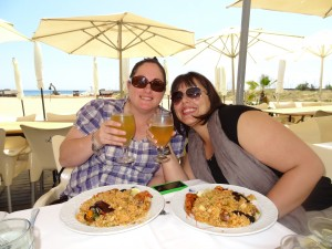 Crystal and Noemi having paelle on the beach